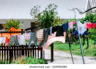 Drying laundry on washing line in garden - Maori village in Rotorua, Bay of Plenty, North Island, New Zealand