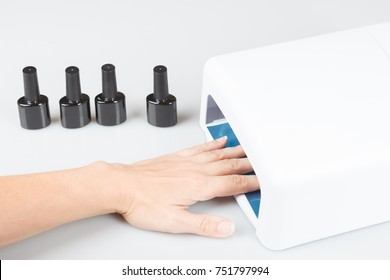 drying nails female hand on light background