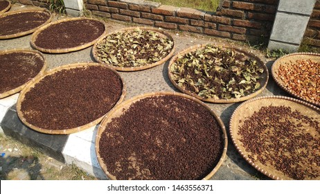 """Drying up natural resources from harvesting such as cloves and nutmeg, by spreading it on the big plate lookalike called 'tampah"""" with selective focus."""