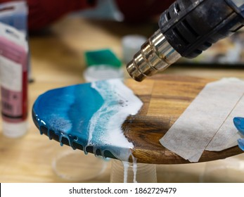 drying paint with a hairdryer on the board