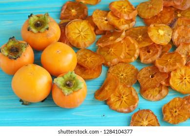 Drying persimmons (lat. Diospyros), sliced. Homemade orange fruit preparations