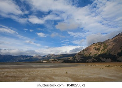 Drying sand flats near Kluane Lake in Yukon Canada in summer with dramatic clouds.