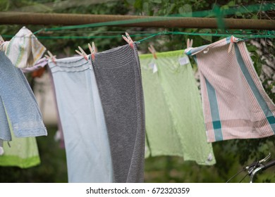 drying sheets on the line in the backyard