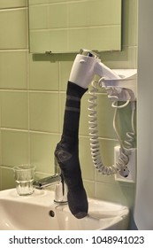 Drying wet socks with a hairdryer after soaking rain