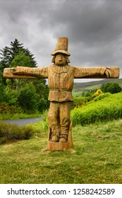 Drynoch, Isle of Skye, Scotland, UK - June 14, 2018: Carved wood life size Tattie Bogle Scarecrow previously pointing to the Tattie Bogal trail on Carbost Road Drynoch Isle of Skye Scotland UK
