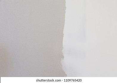 drywall with half covered with joint compound spackle background