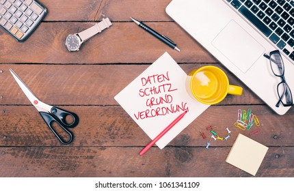 DSGVO, Datenschutzgrundverordnung (German for a new regulation effective May 2018 in European Union on general data protection/privacy) message on paper, grunge office desktop flat lay