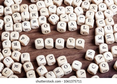 DSGVO (German for new regulation effective May 2018 in European Union on general data protection/privacy) message in letters on cube dices on table.