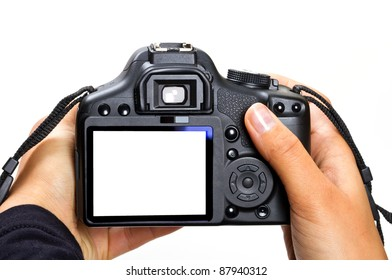 DSLR camera in female hands isolated on white