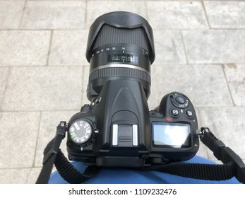dslr camera holding of the photographer neck. subjective view of photographic equipment