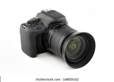 DSLR camera isolated on a white background.