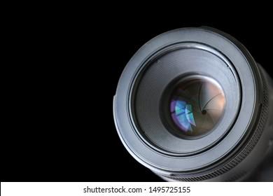 Dslr camera lens and aperture blades on black background.