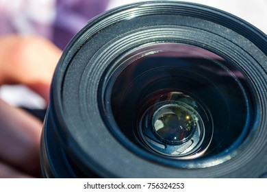 DSLR camera lens with reflections