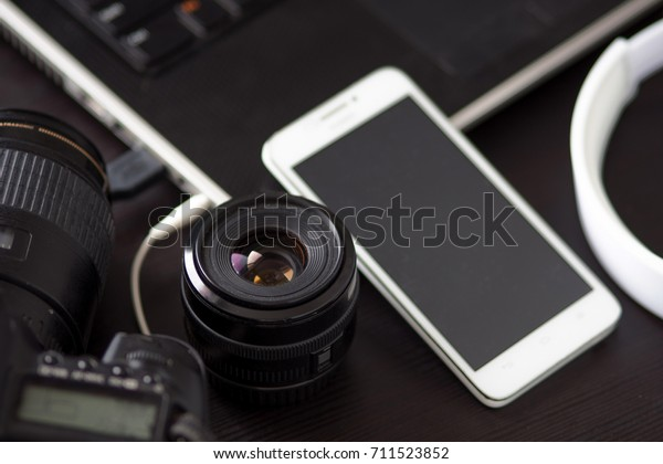 DSLR camera and a mobile phone with built-in camera, for creating and editing photos