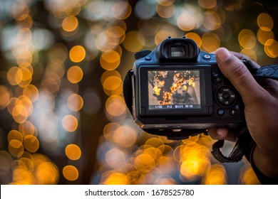 DSLR Camera on Bokeh Background - Black DSLR Camera With Bokeh Lights Photo and Camera City Lights Bokeh