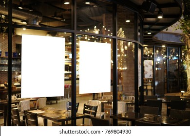 Dual blank promotion poster display on glass window at restaurant or cafe,promotion information for announcement message successful marketing