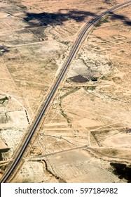 Dual carriage highway on desert in Morocco, Africa, aerial view from top sky. Vertical image