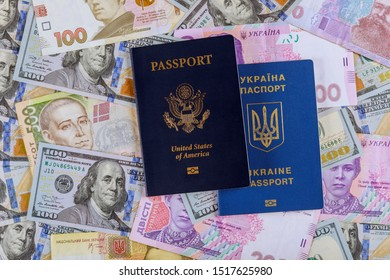 Dual citizens US and Ukrainian passports of US Ukrainian currency money dollar hryvnia banknotes