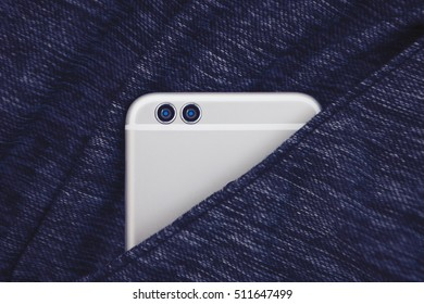 Dual lens camera mobile smartphone in clothes pocket. Big silver gadget. 3d lenses module is the future of mobile photography. Close up