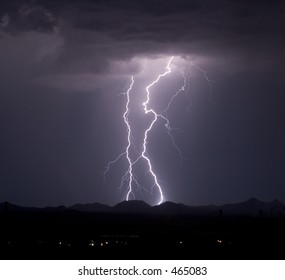 Dual lightning strikes over the Roskruge Mountains in the desert southwest of the United States