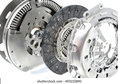 Dual mass flywheel with clutch plate and spring isolated on white background.