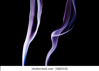 Dual Purple Trails of Smoke on a black background
