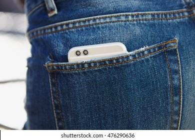 Dual rear camera smart phone in back pocket of jeans. 3d stereo camera with double lens. Buy new smartphone with dual lens camera to be cool. The best phone model of the year