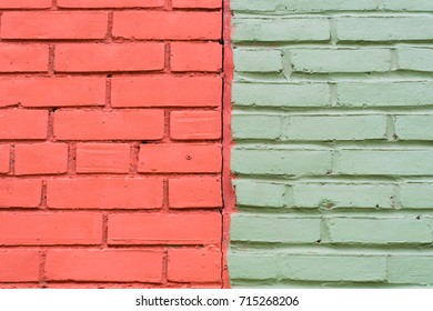 Dual toned brick wall, half of it is brick red and half is light green. Colour contrasts in old buildings.
