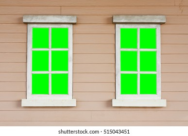 dual or two old wood white window with green screen on the wall vintage cowboy house style scene for background included clipping path for green screen on the window for your idea
