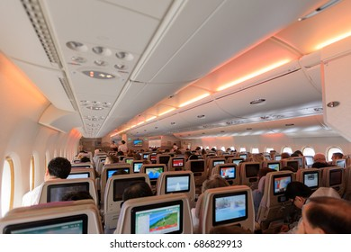 DUBAI - 11 JULY: An interior shot of an airplane while passengers are relaxing during flight as seen on 11 July, 2017.