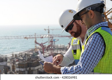 DUBAI. 18.4.2016.  Construction Managers Oversee Site Progress on Construction Site.