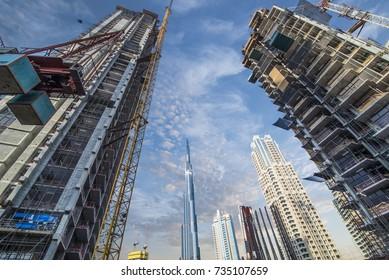 DUBAI - 28.9.2017 - New construction development on Dubai's Emaar Boulevard with blue sky and Dubai's skyline in the background.