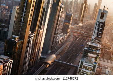 Dubai from above. Dubai skyline on sunset. United Arab Emirates
