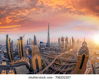 Dubai against colorful sunset with modern futuristic architecture , United Arab Emirates