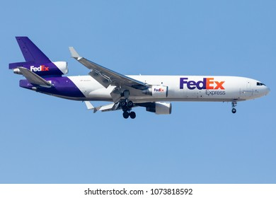 DUBAI - APRIL 21: A FedEx Airline aircraft is landing at DXB airport as seen on April 21, 2018.