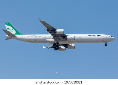 DUBAI - APRIL 21: A Mahan Air aircraft is landing in DXB airport as seen on APRIL 21, 2018.