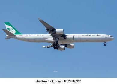 DUBAI - APRIL 21: A Mahan Air aircraft is landing in DXB airport as seen on APRIL 21, 2018.