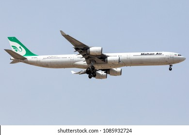 DUBAI - APRIL 25: A Mahan Air Airline aircraft is landing at DXB airport as seen on April 25, 2018.