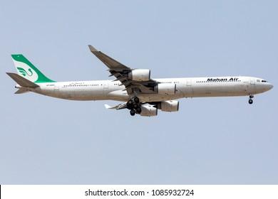 DUBAI - APRIL 25: A Mahan Air Airline aircraft is landing at DXB airport as seen on April 25, 2018.