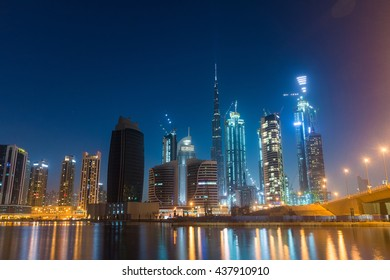 The Dubai business bay on city skyline at night