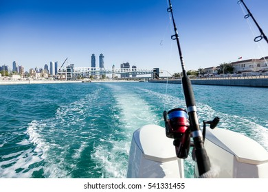 Dubai canal and the new spiral walking bridge as seen on a fishing boat cruising over.