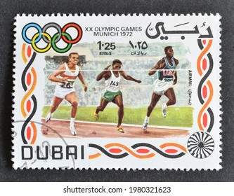 Dubai - circa 1972 : Cancelled postage stamp printed by Dubai, that shows Race, promoting Summer Olympic Games 1972 - Munich, circa 1972.