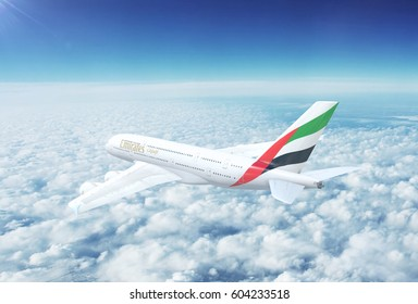DUBAI - CIRCA 2017: In-flight view of Emirates Airbus A380 Commercial Passenger Aircraft Flying High Up in the Sky Above the Clouds. 3D Illustration.
