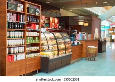 DUBAI - CIRCA NOVEMBER, 2016: a Starbucks cafe in Dubai International Airport. Starbucks Corporation is an American coffee company and coffeehouse chain.