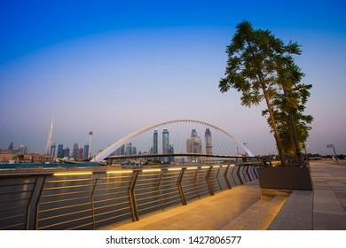 Dubai city skyline at night. view of Tolerance bridge