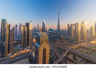 Dubai city skyline panoramic view with metro and cars moving on city's busiest highway