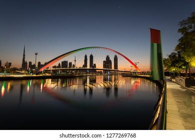 Dubai city skyline at sunrise. view of Tolerance bridge.