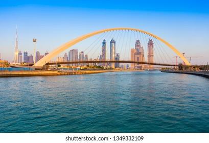 Dubai city skyline at sunset. view of Tolerance bridge