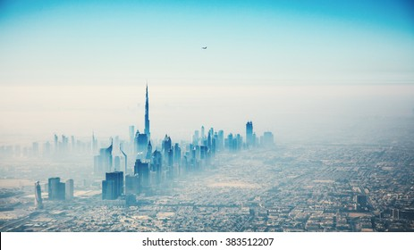 Dubai city in sunrise aerial view