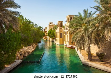 Dubai city view with palm trees and old wind towers